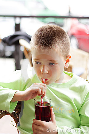 Boy with cold drink