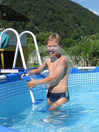 Boy in collapsible pool