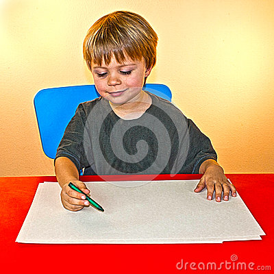 Boy coloring on blank piece of paper