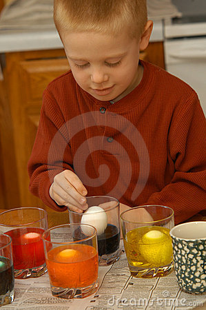 Boy Coloring Eggs