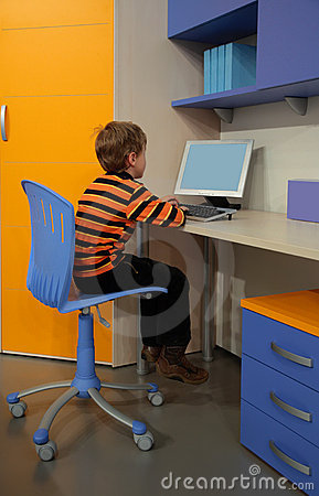 Boy at computer in children s room