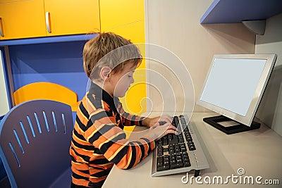 Boy at computer in children s room