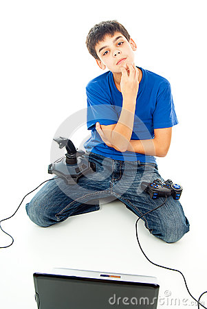Boy with computer and with two joysticks
