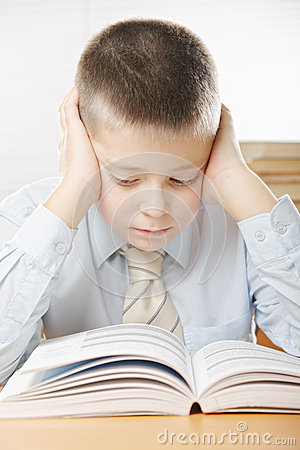 Boy concentrated on reading