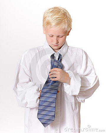 Boy Concentrating on Tying Men s Necktie