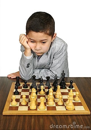 Boy contemplating chess move