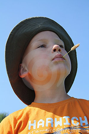 Boy with corn stalk in mouth