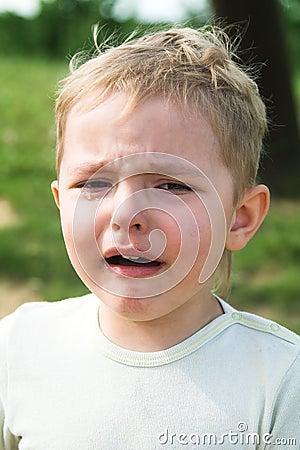 The boy cries