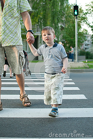 Boy crossing the street at a crosswalk