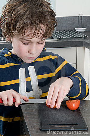 Free Boy Cutting Tomato Stock Photos - 18053683