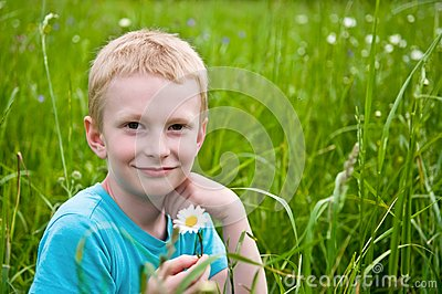 Boy with daisy
