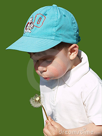 Boy and dandelion