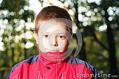 Boy in dark forest