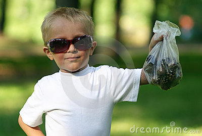Boy in dark glasses with a package of pines