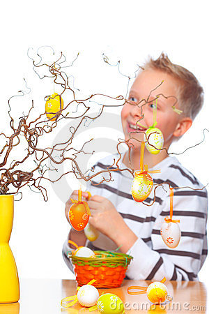 Boy decorating easter bunch