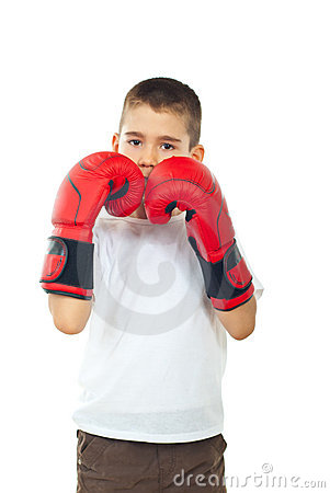 Boy defending with boxing gloves