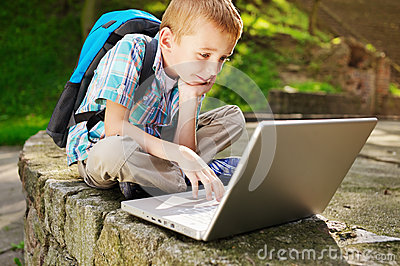 Boy delighted with laptop