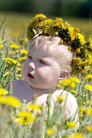 Boy with diadem from dandelions