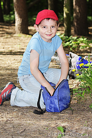 Boy digging in bag