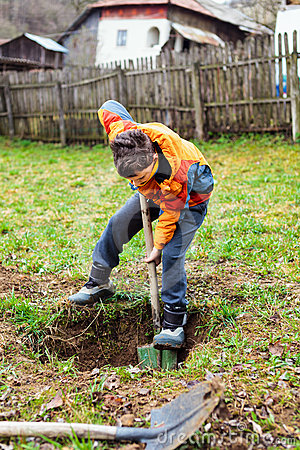 Boy digging in the ground royalty free stock photo image for Digging ground dream meaning