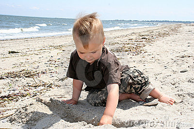 Boy digging in the sand