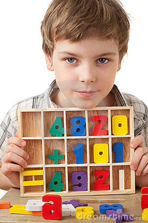 Boy displays wooden figures in form of numerals