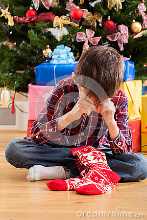 Free Boy Dissatisfied With Christmas Present Stock Images - 46055444