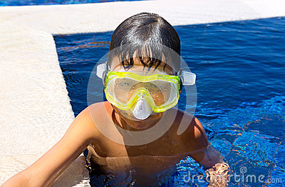 Boy diver in a swimming-pool