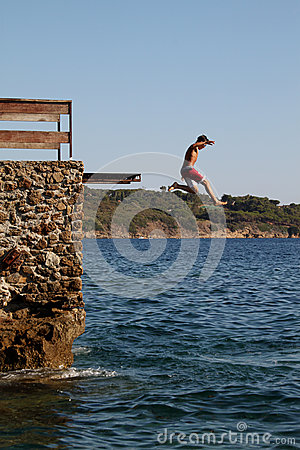 Boy dives