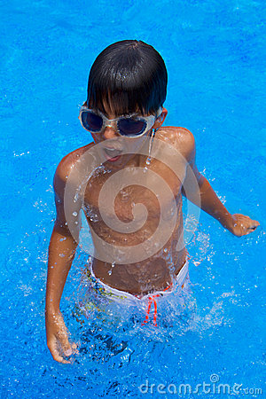Boy diving in pool
