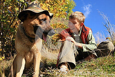 Boy and dog – sunny fall