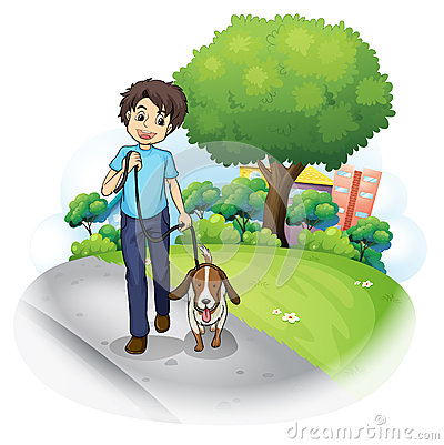 A boy with a dog walking along the street