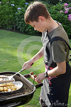Free Boy Doing Barbecue Royalty Free Stock Photos - 74543518