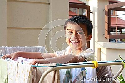 Boy Doing Laundry