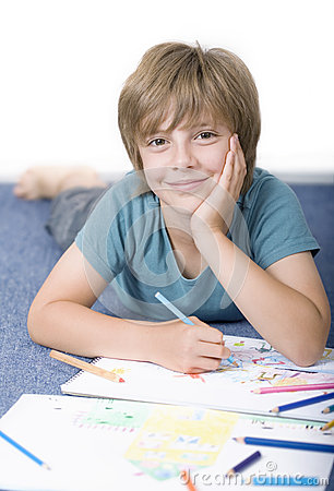 Boy draw with crayons