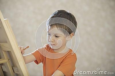 Boy Drawing On Canvas