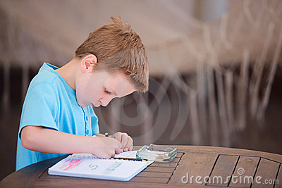 Boy drawing or writing