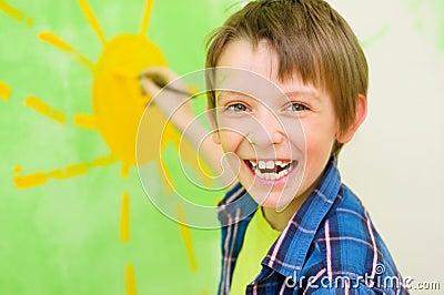 Boy draws the sun