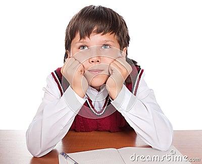 The boy dreams in a class