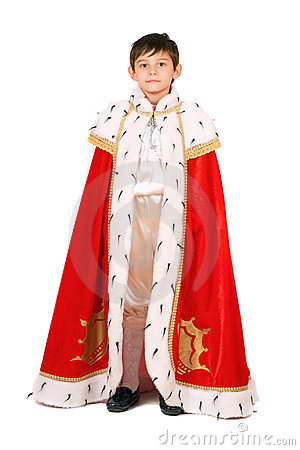 Boy dressed as a king. Isolated