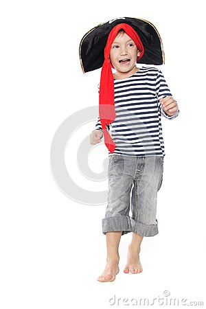 Boy dressed as pirate over white