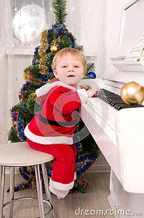 Boy dressed as Santa Claus
