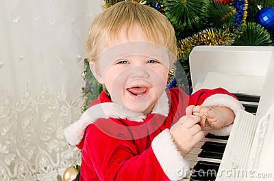 Boy dressed as Santa Claus