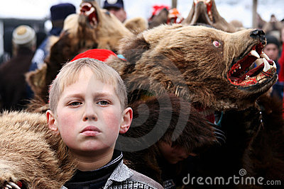 Boy dressed in bear skin Editorial Stock Photo
