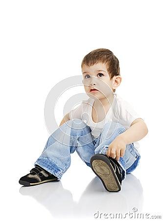 The boy dresses shoes