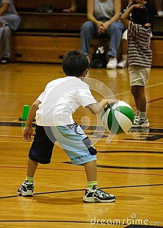 Boy dribbling basketball