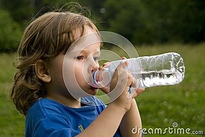 Boy Drinking Bottled Water.