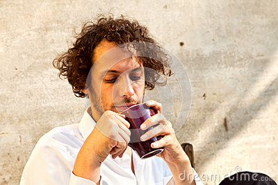 Boy drinking a cup of tea