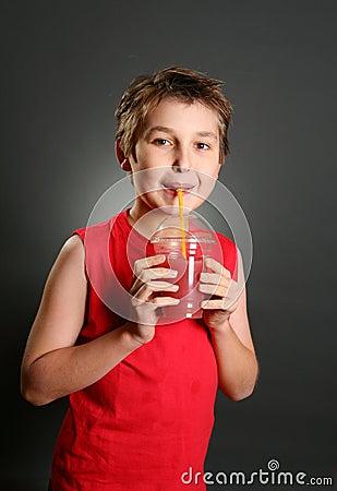 Boy drinking fresh berry juice