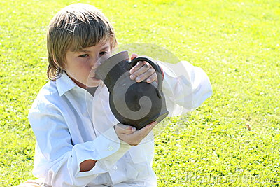 Boy drinking from a pitcher